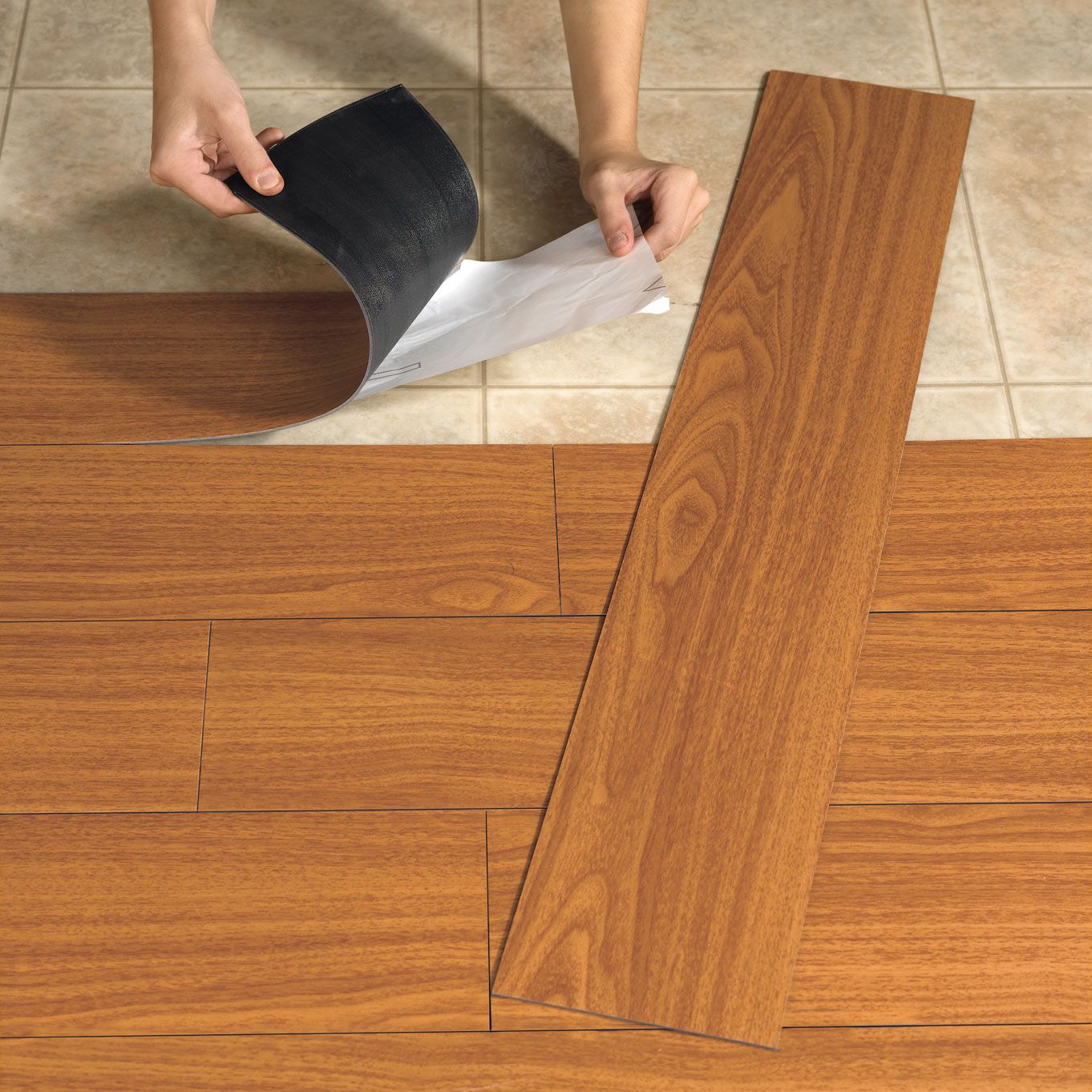 Laminate vs vinyl flooring scottsdale flooring america for Pvc hardwood flooring
